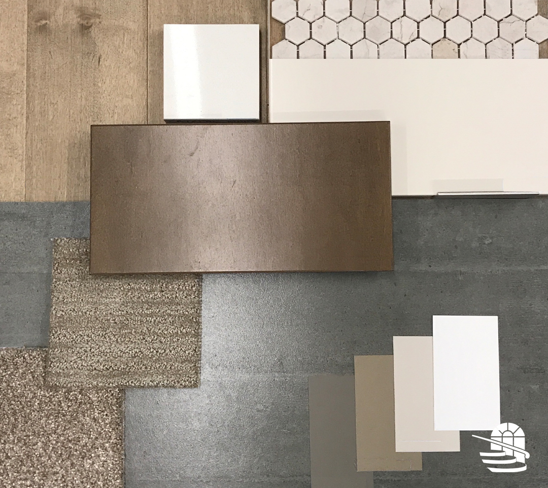 Flat lay of home finishes such as hardwood floor, tile, carpet, cabinet doors